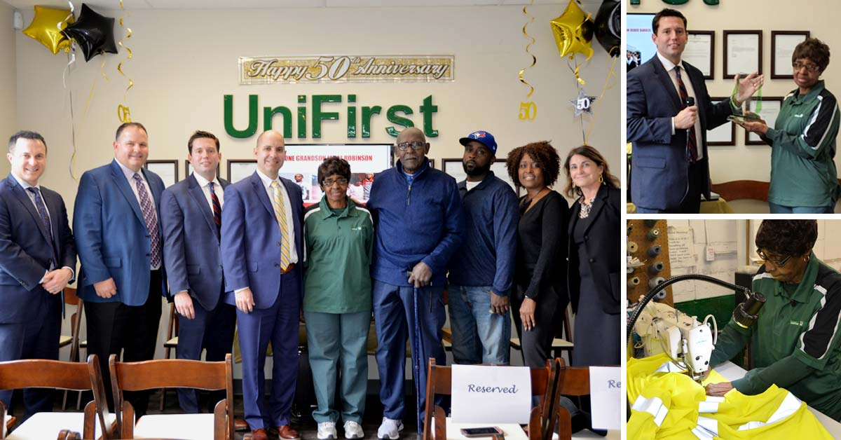 UniFirst executives honored Team Partner Mittie Barber for her 50-Year work anniversary with a surprise celebration.  From left: UniFirst regional vice president Benji Clause, senior vice president Michael Croatti, general manager Clinton Bell, president and CEO Steven Sintros, Mittie Barber, husband Johnny Barber, son Derek Barber, daughter Felicia Barber, and executive vice president Cynthia Croatti.