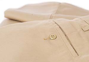Clean, folded uniform pants showing pocket