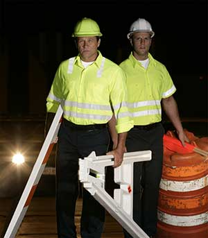 Roadway workers wearing hi-vis apparel at night