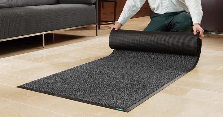 Unifirst Employee Rolls Out Cleaned Commercial Floor Mat