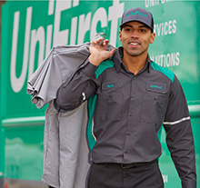 Man delivering clean uniforms out of van