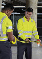 Two men working in ANSI-rated, high vis clothing