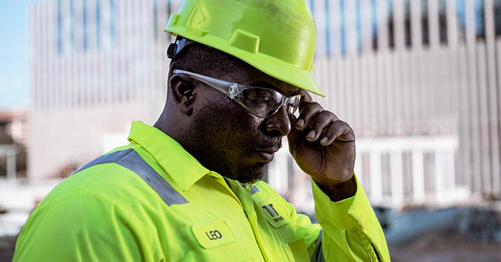 Night workers wearing hi-visibility protective clothing