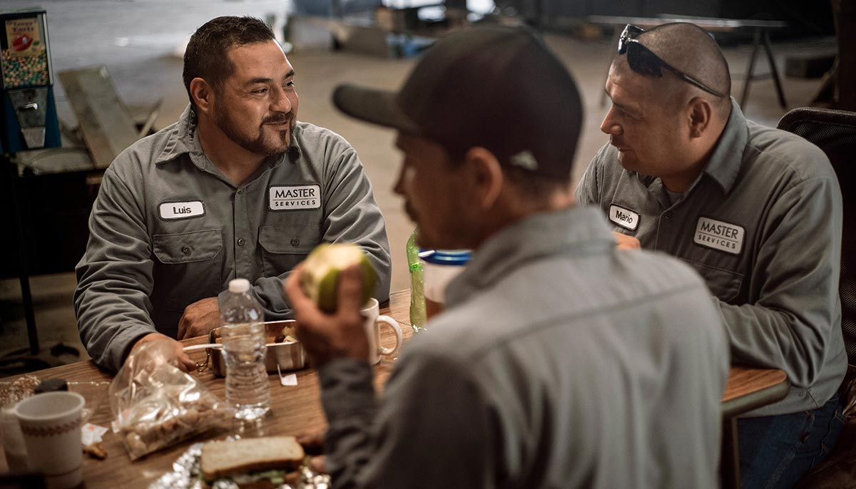 Employees wearing  custom, branded work uniforms by UniFirst