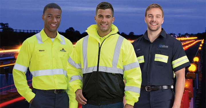 Night road workers wearing high-visibility clothing that meets ANSI standards