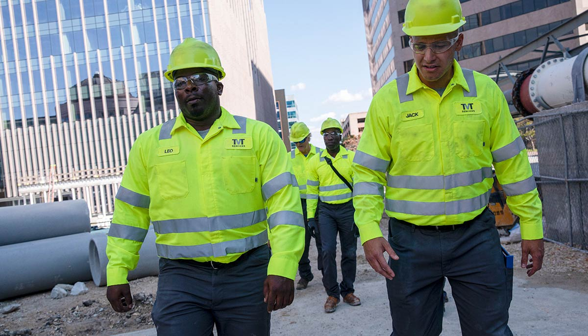 Two men in ANSI-rated, High Visibility uniforms