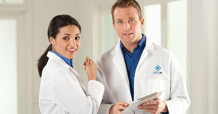 Male doctor and female doctor wearing lab coats