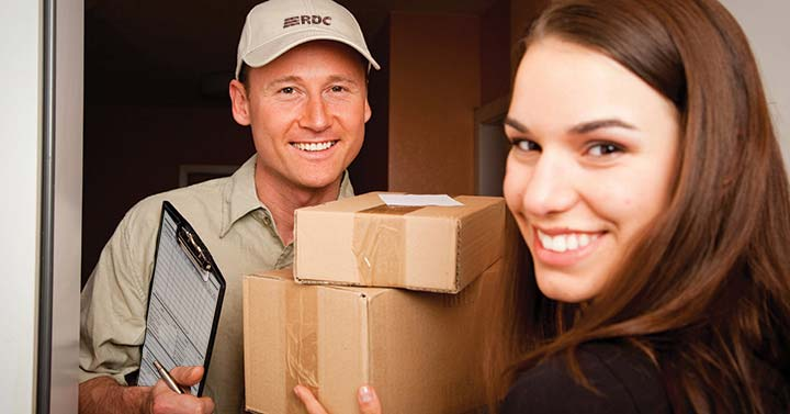 Woman accepts packages from delivery man